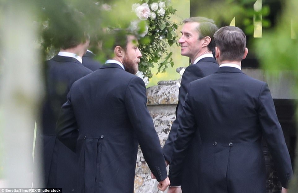 A beaming James Matthews, second from right, arrives at the church flanked by ushers Jame and brother Spencer as he awaits his bride