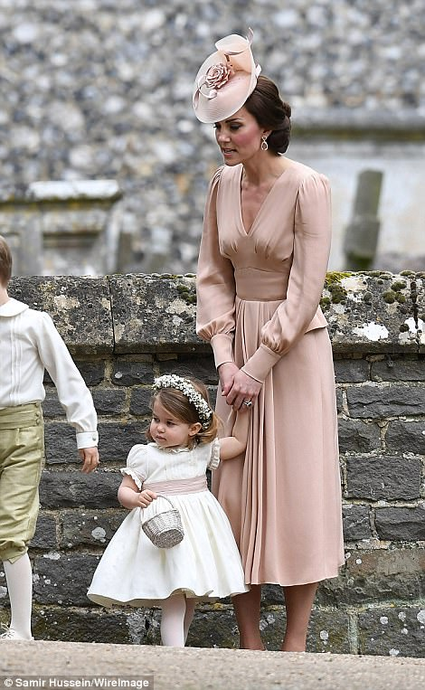 Mother-of-two Kate looked chic in an Alexander McQueen dress as she held her little daughter's hand