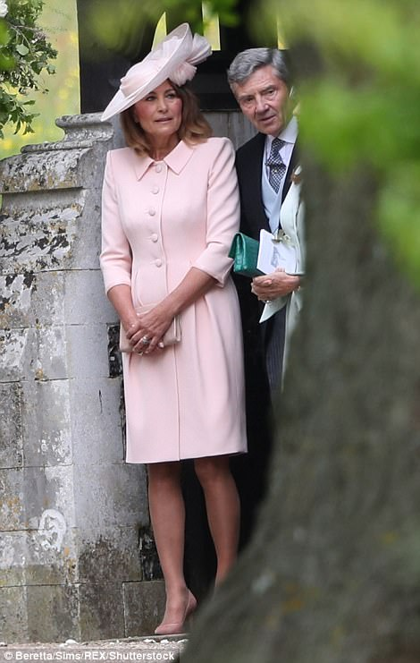 Carole was the epitome of chic in a peach dress and matching fascinator in keeping with the colour scheme