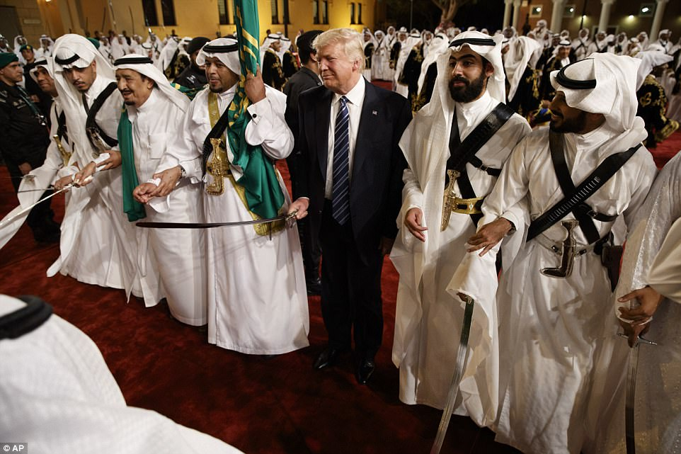 Trump gripped the sword as he stood beside traditional dancers during a welcome ceremony at Murabba Palace