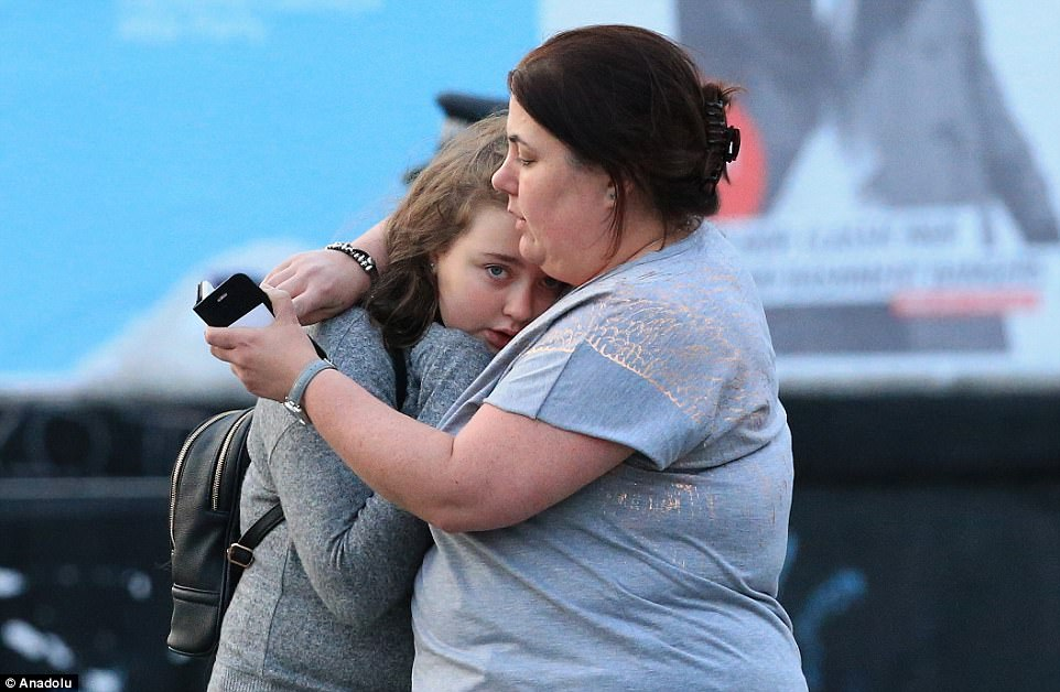 Two of the walking wounded, Vikki Baker and her 13-year-old daughter Charlotte, hugged at the scene of the attack today
