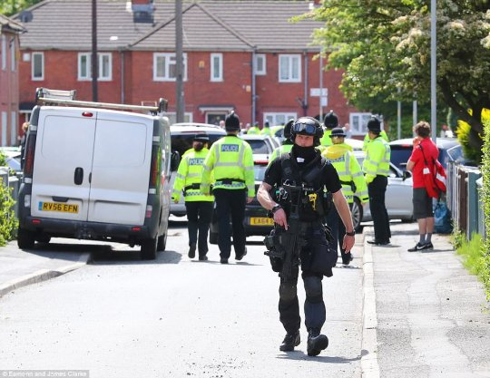 A huge number of police - including armed officers carried out a raid on a house in the Fallowfield area of the city today