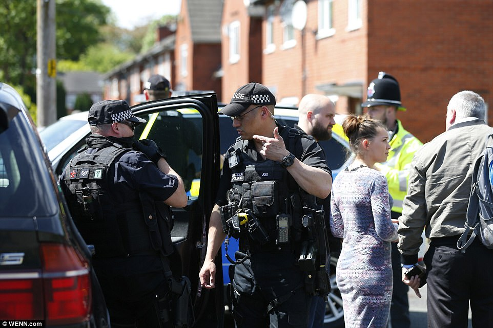 Officers descended on a street in the south of Manchester today to search a house where the bomber is believed to have lived