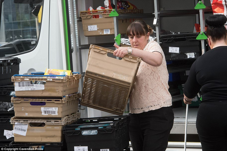 Volunteers unloaded supplies for those who were being looked after by experts inside the famous stadium this afternoon