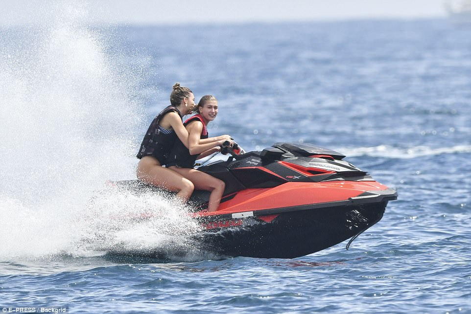 Whipping through the waves! Hailey sped through the sea as her friend held on tight to her pal
