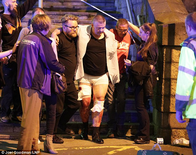 Concert-goers helped injured people away from the gig last night. Witnesses describe the scene as 'like a warzone'