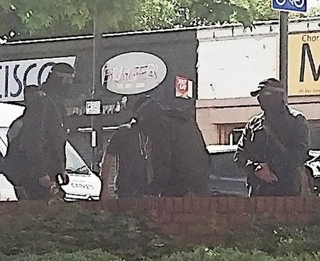 Non-uniform anti-terror officers wearing masks to conceal their faces were seen emerging from a Black Mercedes before arresting a man outside a Morrison's in Chorlton