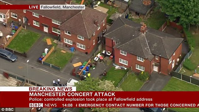 Aerial shots showed police descending on a house in Fallowfield, Manchester as part of the investigation into the bombing massacre last night