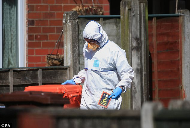 A forensic investigator emerged from the house carrying a booklet called 'Know Your Chemicals'