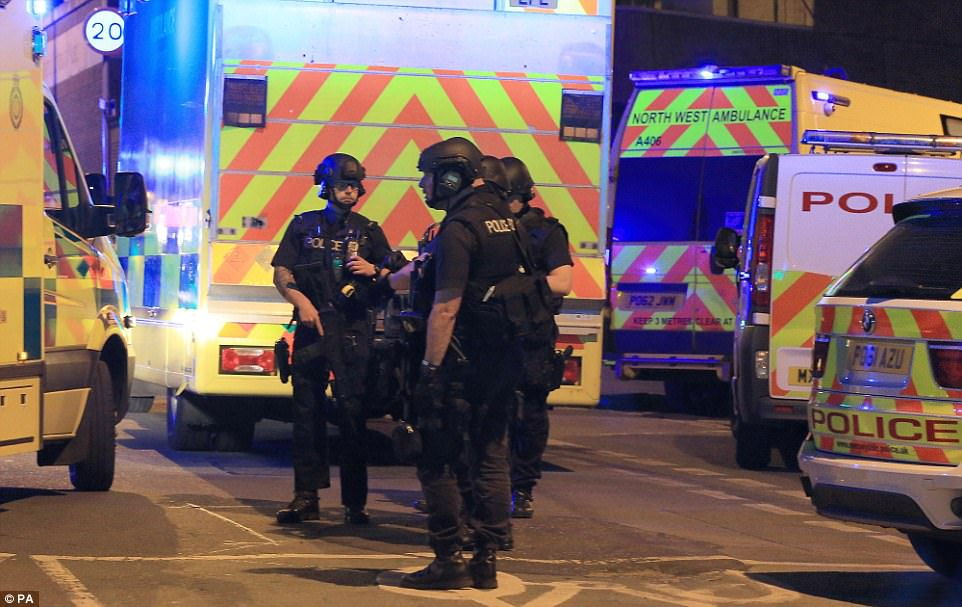 Armed police spotted outside the gig following reports of an explosion at the venue during the Ariana Grande gig
