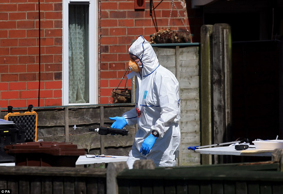 Forensics wearing white suits were called to an address in Greater Manchester after a police operation