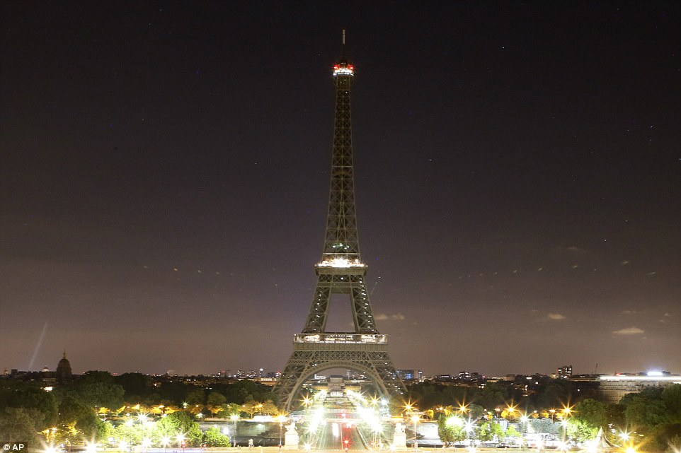 Poignant:The lights of the Eiffel tower fell dark at midnight in Paris on Tuesday to honor the victims of the suicide attack at an Ariana Grande concert that left 22 people dead