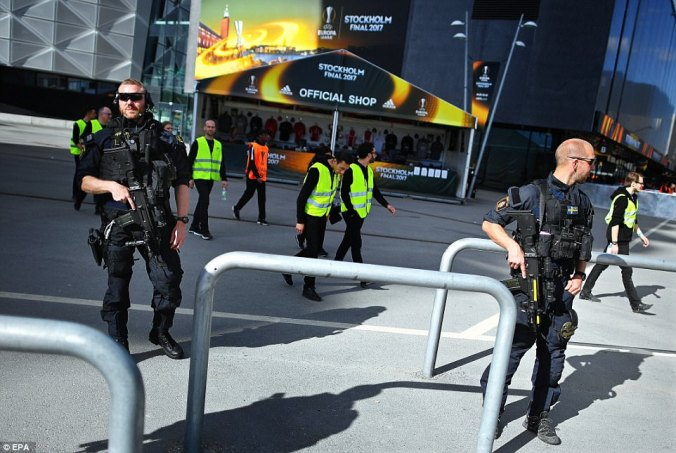 Outside the stadium local police joined by heavily armed special officers, as Sweden stepped up its security