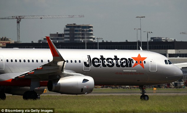 An airport ground worker was forced to run away from a Jetstar plane (stock image) after its pilot started the engines and began to taxi while he was still connected by a headset