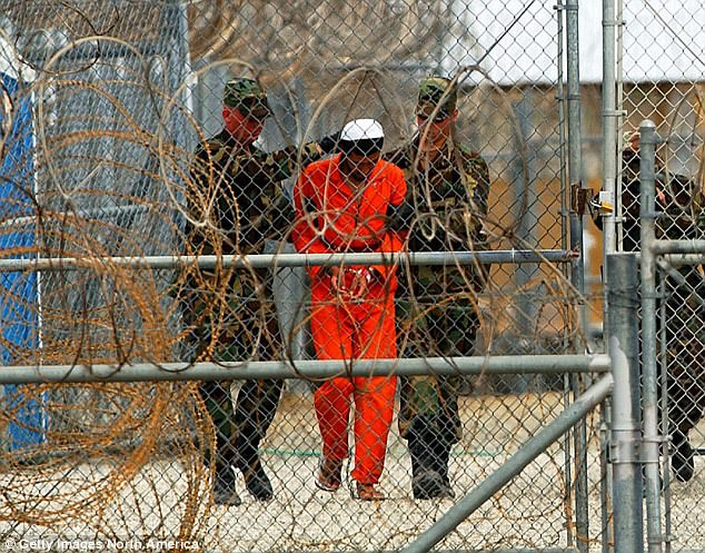 Tarique Ghaffur warns there are too many extremists on the streets for police and MI5 officers to monitor (file photo of a prisoner atin Guantanamo Bay, Cuba)