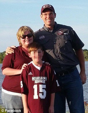 Tragic: Lincoln County Sheriff Deputy William Durr (pictured with his wife and son), 36, was killed in a shooting at 11:30pm along with three females at a home in the 2800 block of Lee Drive in Bogue Chitto, Mississippi. The suspect, Willie Cory Godbolt, is in custody