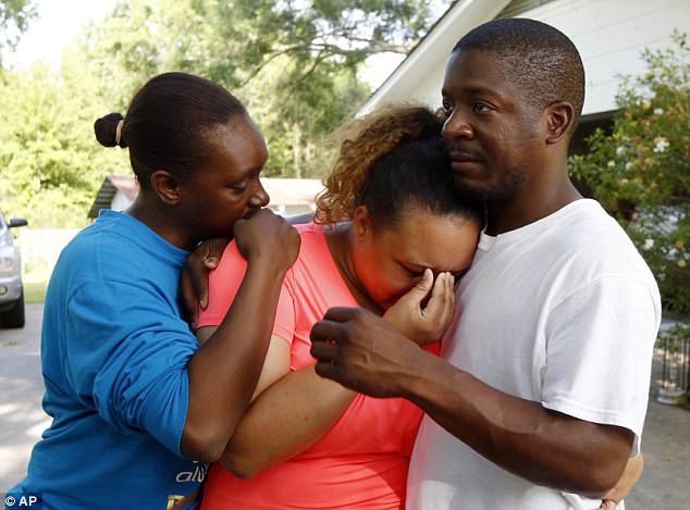 Pictured Christianna May-Kelly, center, broke down in tears, saying her parents were among the people gunned down in Brookhaven