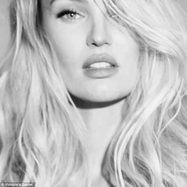 Blonde bombshell: Candice wears long fake eye lashes and has her lips made-up as a cupid's bow for the video shoot