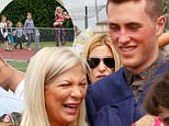 If looks could kill: Mary Jo Eustace, 55, was seen glaring over the shoulder of Tori as she congratulated her stepson Jack McDermott after the ceremony