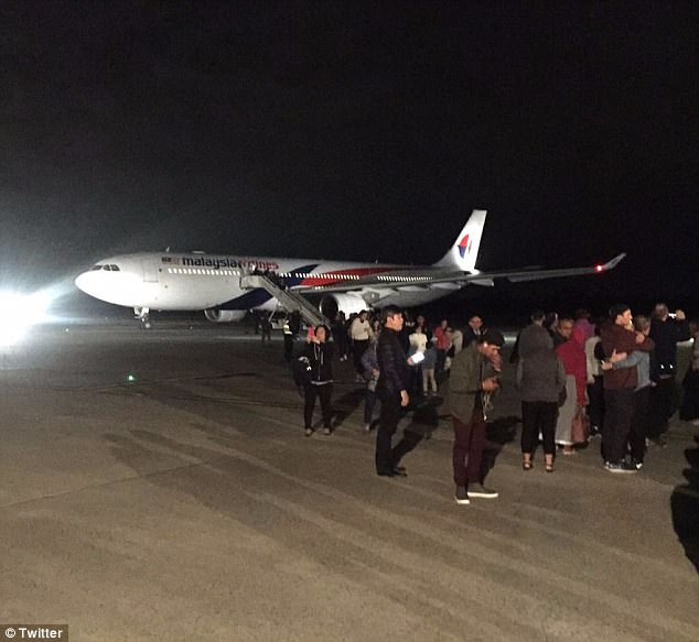 After making an emergency landing the plane sat on the tarmac with passengers still onboard for more than two hours, with passengers disembarking (pictured) shortly before 2am