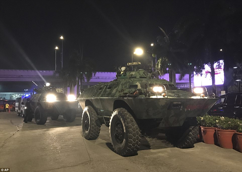 As well as armed officers military tanks were positioned outside the complex in the early hours of Friday morning