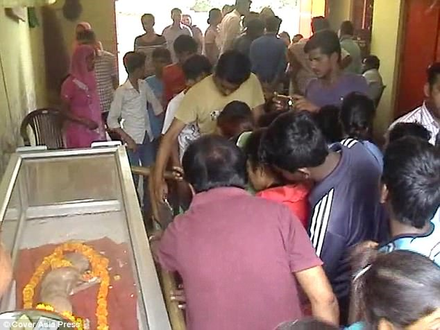 Hundreds of locals came to venerate the dead calf who died in  Uttar Pradesh, northern India