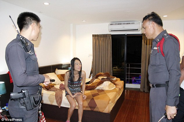 Police were seen questioning Sittipong Maneekat, 35, a transsexual prostitute, at the scene