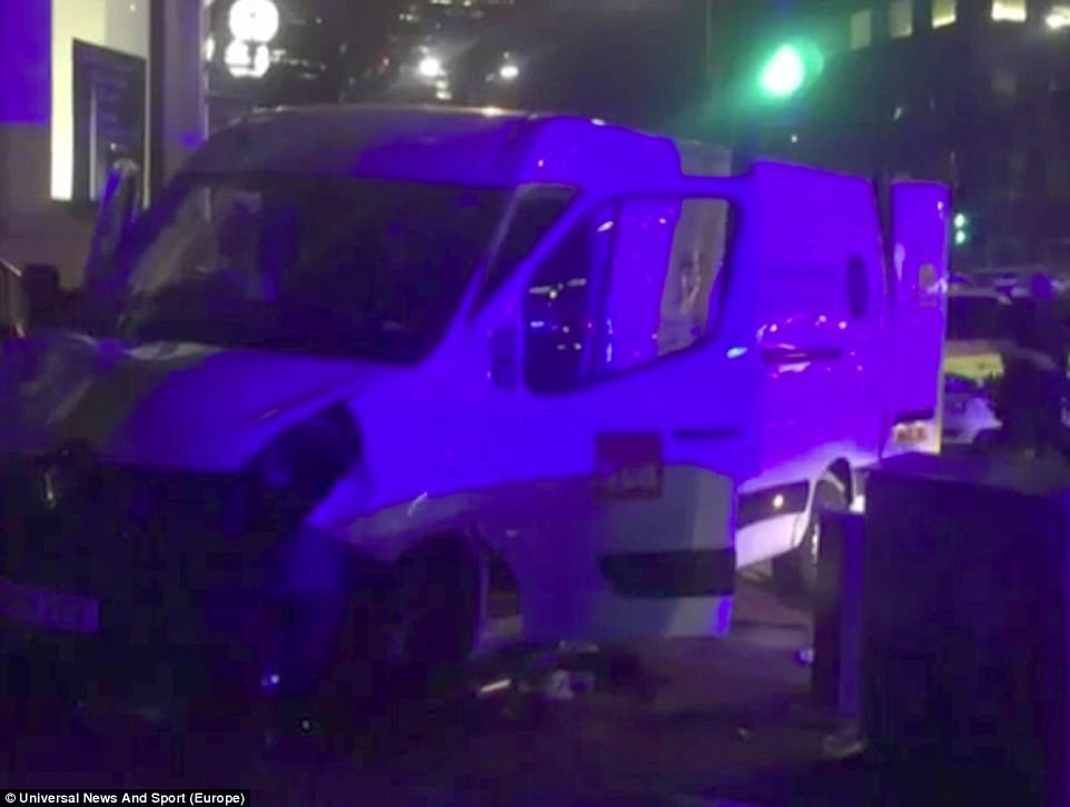 Pictured, the van - which is believed to be a B&Q and Hertz vehicle - that was used to mow down unsuspecting pedestrians. Witnesses said it veered in an 'S shape' across the bridge and drove towards the Shard and was south of the river