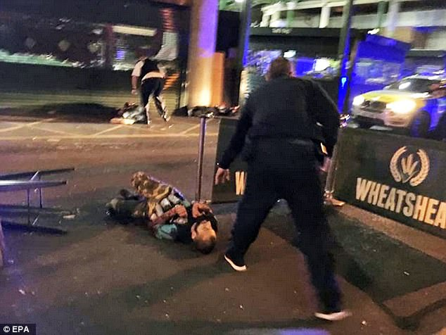 The three attackers (one suspect seen lying down, with fake bomb vest) drove into people on London Bridge just after 10pm Saturday, then ran through a popular nightlife area, attacking civilians before they were shot by police