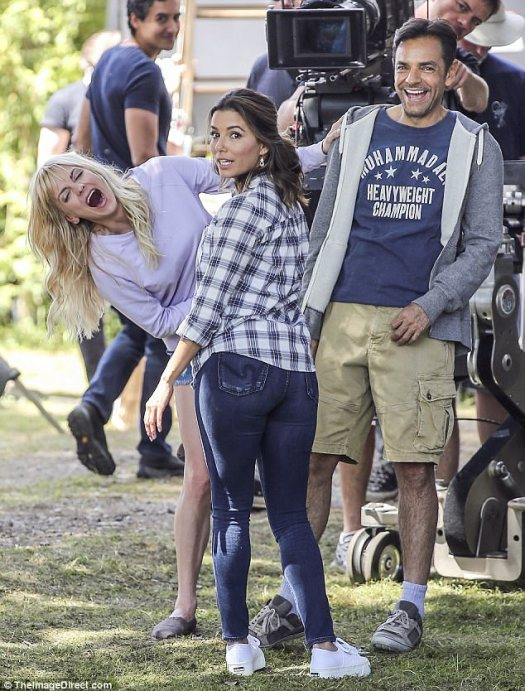 Booty-ful comedy:nna Faris got her costar Eva Longoria laughing on set of their new movie, a remake of 1987 comedy Overboard, in Vancouver on Tuesday