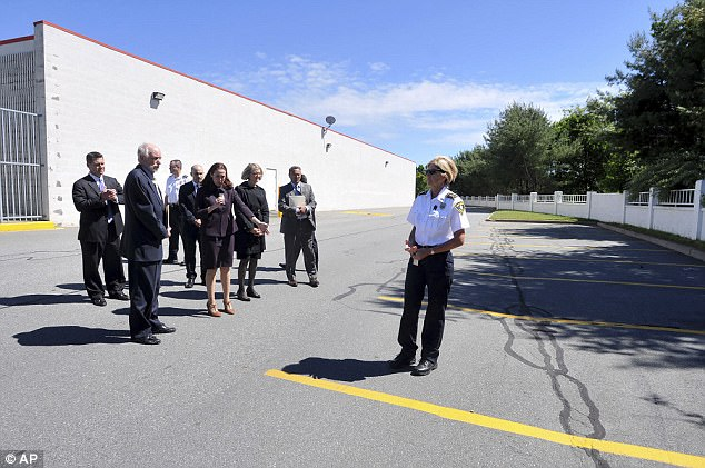 A court officer stands in the spot where the pickup truck that contained the body of Conrad Roy III was was found in July, 2014 at a former K Mart store parking lot in Fairhaven as District Attorney Katie Rayburn points to the spot while Judge Lawrence Moniz looks on