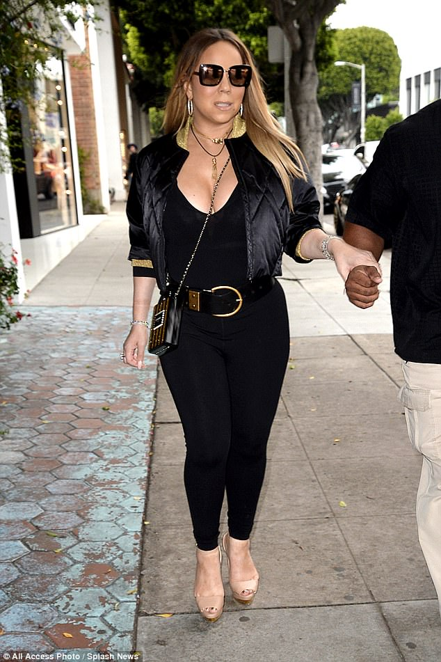 Not one for casual wear: It was just another day in Mariah's world - she also indulged in some retail therapy in LA last week, and also refused to ditch her heels then