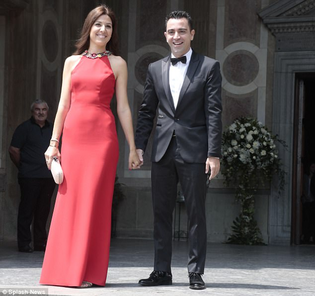 Iconic midfielder Xavi and his wife pose for a photograph at the service