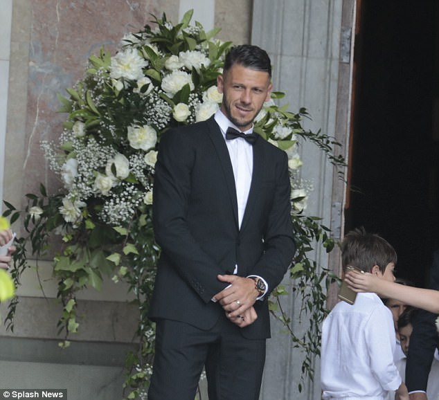 Ex-Manchester City defender Martin Demichelis stands outside the church