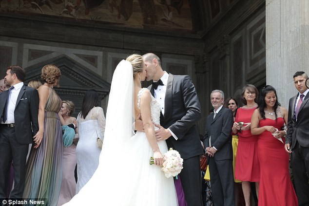 Valdes embraces his new wife, who is a Colombian model, after their wedding