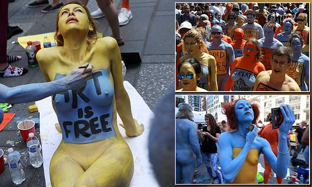 Models pose naked in New York's Times Square for exhibit