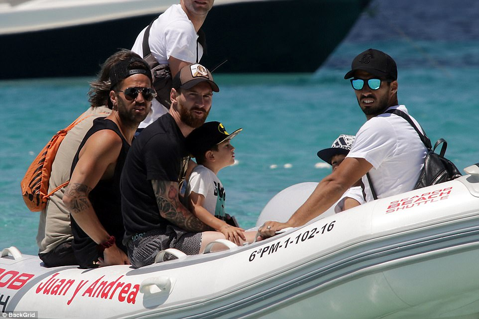 Let's go: The footballing trio made their way across the Med in a small speedboat with an extended group of friends