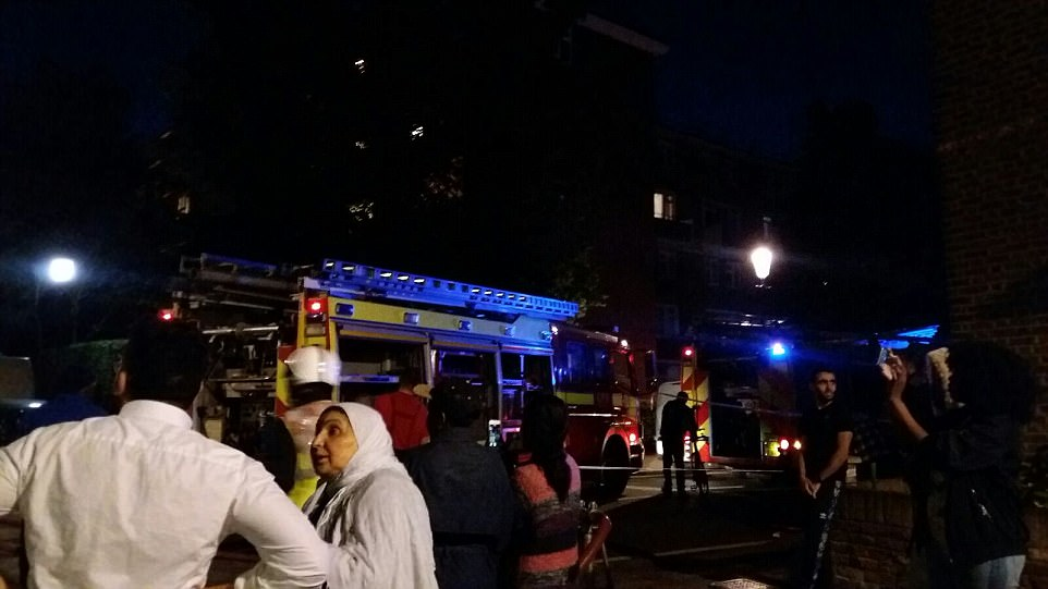 Police and 40 fire engines have rushed to the scene as hundreds of concerned residents gathered outside to try to contact their loved ones