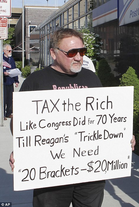 Hodgkinson is seen above in 2012 protesting outside the United States Post Office in his hometown of Belleville, Illinois