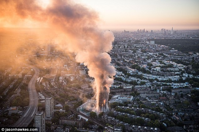 This aerial photo taken hours after the fire ripped through the tower block shows the devastating scale of the inferno