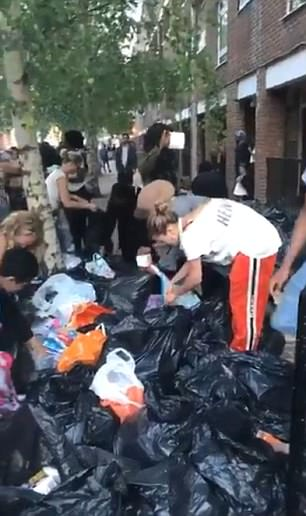 Generous donations: Rita and her fellow Londoners were  sorting through bin bags full of clothing