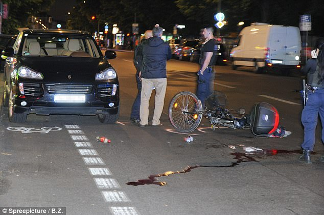 The cyclist landed on his head after colliding with the door of the Saudi Arabian diplomat's £100,000 Porsche