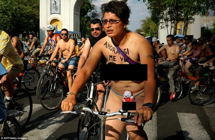 Hundreds of riders pedalled along in Guadalajara, Jalisco state, as part of World Naked Bike Ride (WNBR)