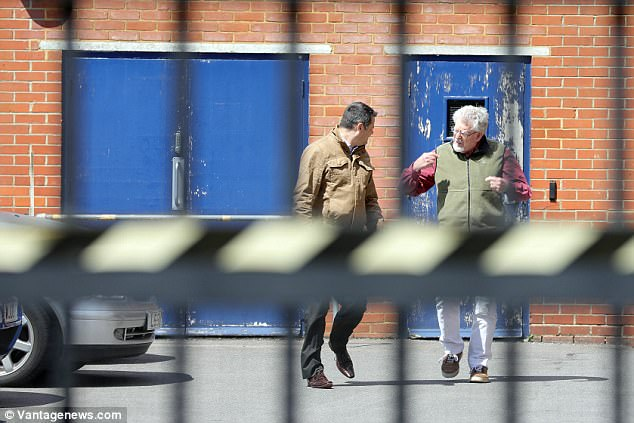 He was seen talking to another man as he walked away from the building before getting into a car
