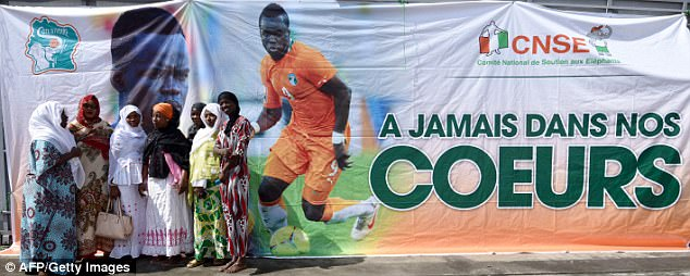 A banner states that the late midfielder 'will always be in our hearts'