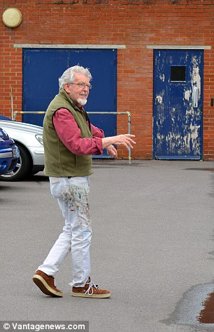 He was photographed with paint on his trousers