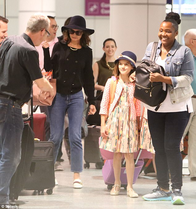 Like mother, like daughter! Katie Holmeswas spotted at Montreal on Monday with her little girl Suri Cruise, 11, who was perfectly outfitted in a pink patterned dress, sweater, sparkling flats, and stylish dark blue hat