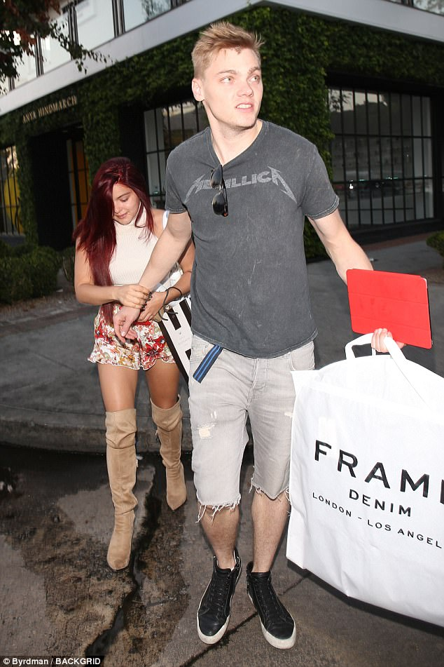 Leading man: Her live-in boyfriend joined her after she got her red tresses blown out at Nine Zero One salon
