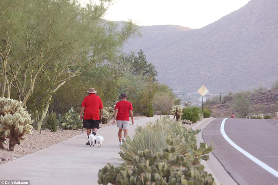Phoenix and Las Vegas are used to 110-degree heat, but temperatures above 115 are rare. Above two people walk their dogs in Phoenix early Tuesday morning before it heats up outside