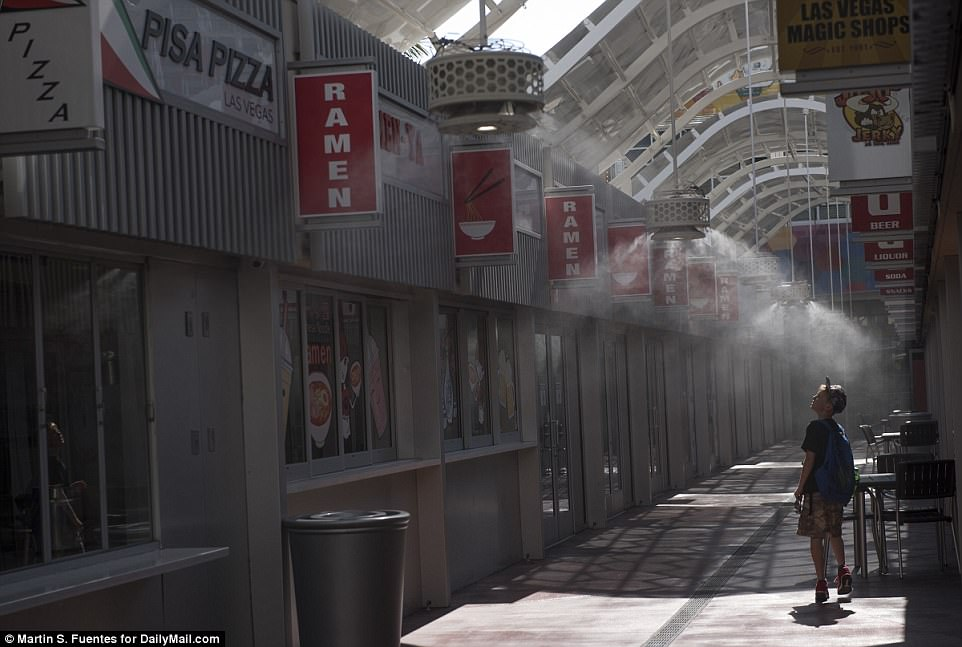 Officials have warned for people to stay inside on Tuesday in several Southwestern states due to the extreme temperatures outside. Above a young boy walks through misters to stay cool at the Grand Bazaar Shops in Las Vegas on Tuesday